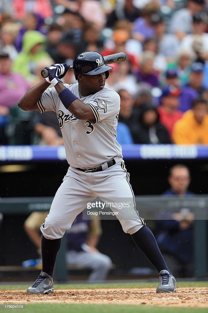 Yuniesky Betancourt of the Milwaukee Brewers takes an at bat against the Colorado Rockies at Coors Field on July 28 2013 in Denver Colorado The...