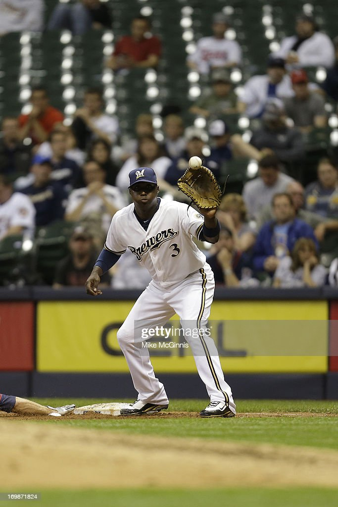 Yuniesky Betancourt of the Milwaukee Brewers takes the throw at first base against the Minnesota Twins during the interleague game at Miller Park on...