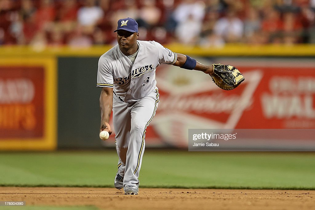 Yuniesky Betancourt of the Milwaukee Brewers throws to first base against the Cincinnati Reds at Great American Ball Park on August 23 2013 in...