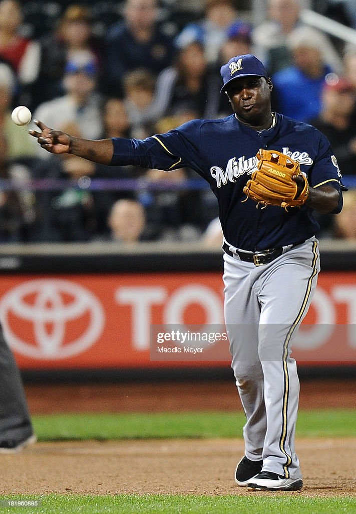 Yuniesky Betancourt of the Milwaukee Brewers throws to first base to force out Matt den Dekker of the New York Mets in the sixth inning on September...