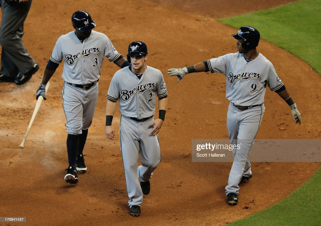 Yuniesky Betancourt Scooter Gennett and Jean Segura of the Milwaukee Brewers celebrate during a three run second inning during the game against the...