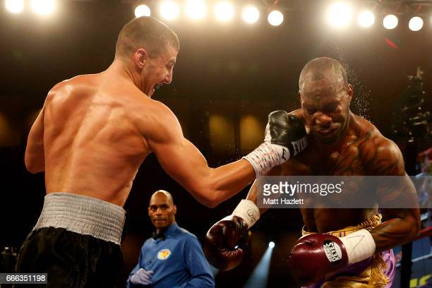 Yuniesky Gonzalez exchanges punches with Oleksandr Gvozdyk of Ukraine during their NABF/NABO Light Heavyweight Championship bout at The Theater at...