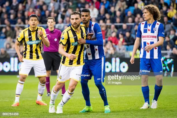 Yuning Zhang of Vitesse Guram Kashia of Vitesse Jerry Jeremiah St Juste of sc Heerenveen Wout Faes of sc Heerenveenduring the Dutch Eredivisie match...