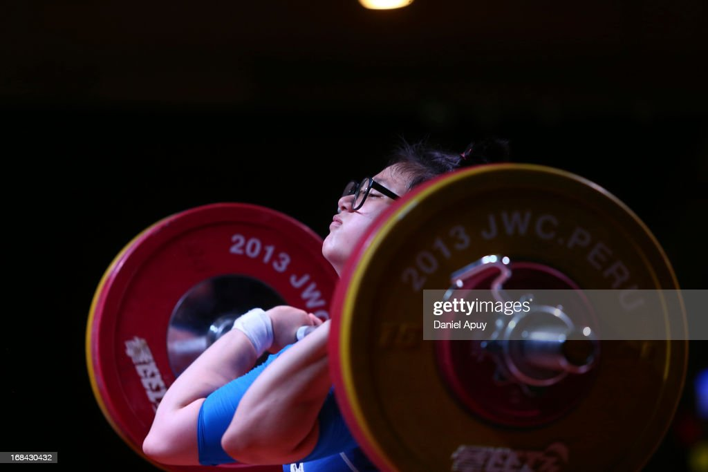 Yunjeong Yeom of Korea A competes in Women's 75kg during day six of the 2013 Junior Weightlifting World Championship at Maria Angola Convention Center on May 09, 2013 in Lima, Peru.