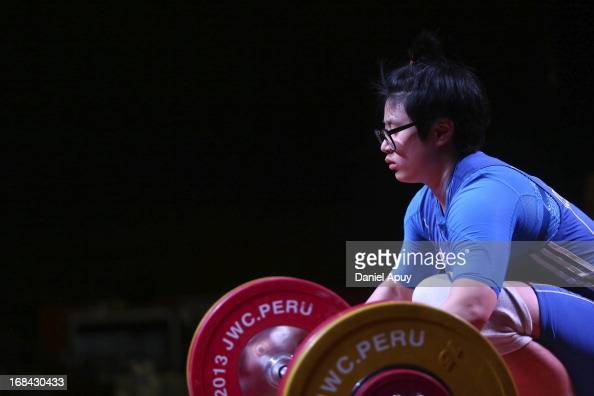 Yunjeong Yeom of Korea A competes in Women's 75kg during day six of the 2013 Junior Weightlifting World Championship at Maria Angola Convention...