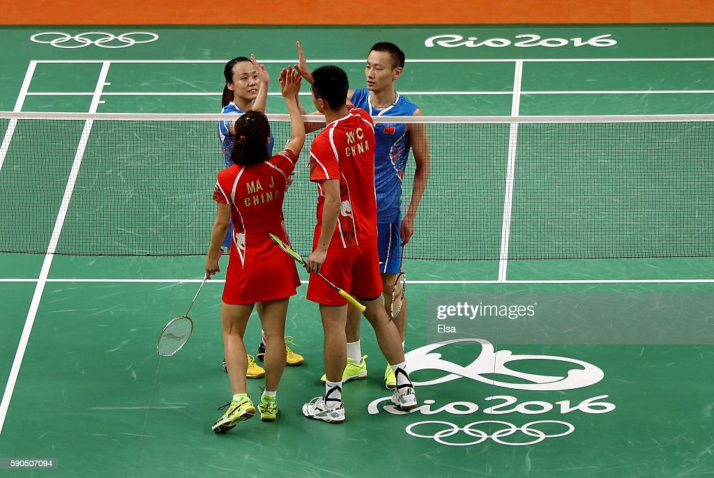 Yunlei Zhao and Nan Zhang of China are congratulated for their bronze medal Mixed Doubles win by Chen Xu and Jin Ma of China on Day 11 of the Rio...