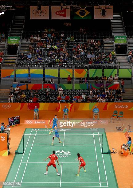 Yunlei Zhao and Nan Zhang of China take on Chen Xu and Jin Ma of China during the bronze medal Mixed Doubles match on Day 11 of the Rio 2016 Olympic...