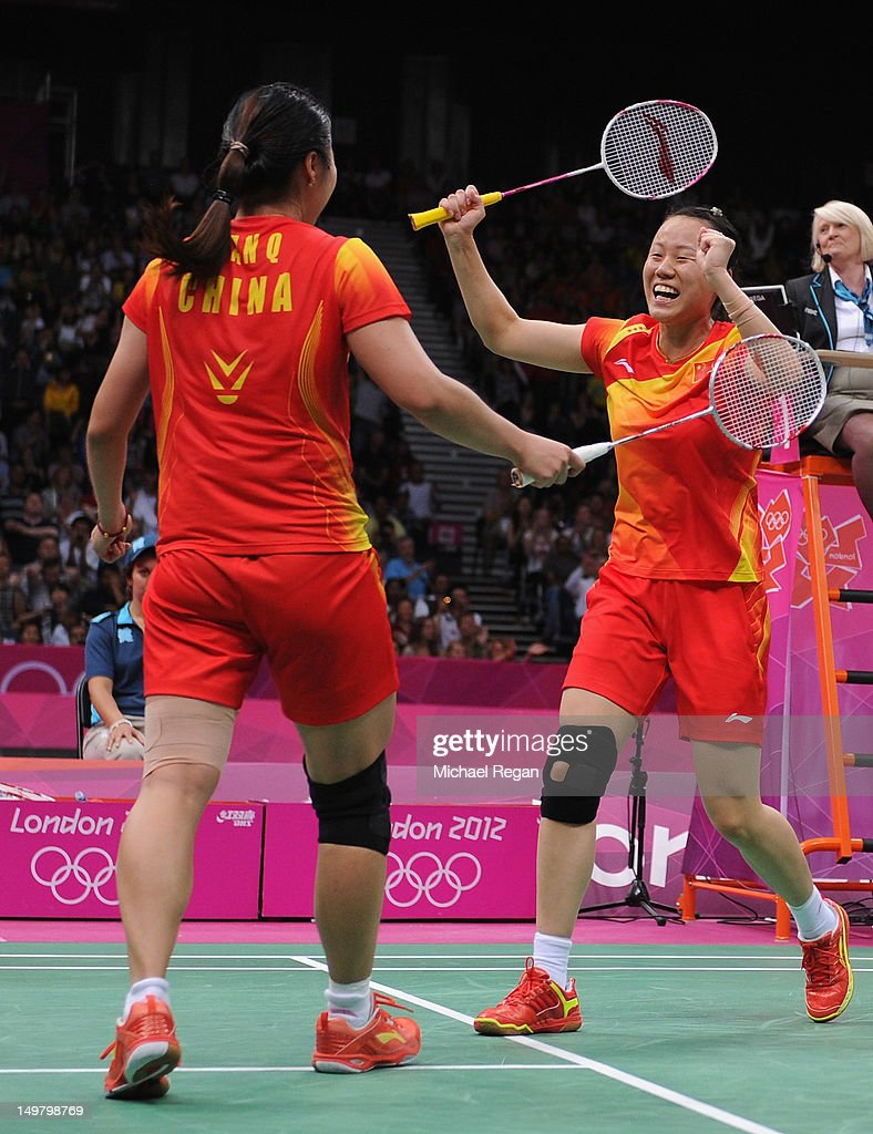 Yunlei Zhao (R) and Qing Tian of China celebrate victory against Kakiiwa and Mizuki Fujii of Japan during their Women's Doubles Badminton Gold Medal match on Day 8 of the London 2012 Olympic Games at Wembley Arena on August 4, 2012 in London, England.