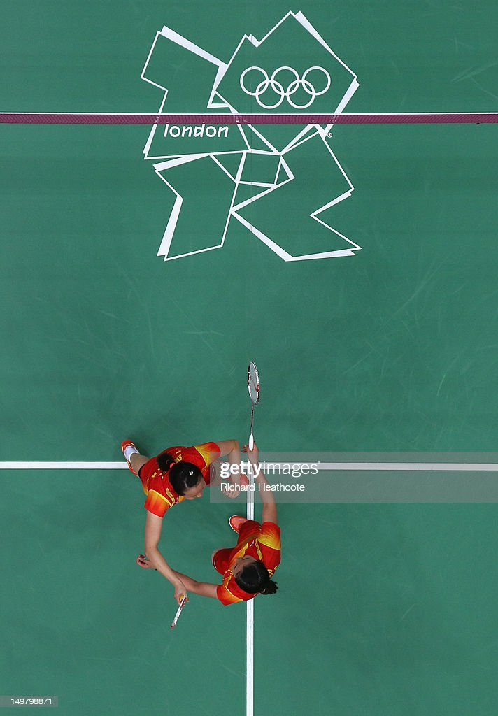 Yunlei Zhao (L) and Qing Tian of China celebrate victory against Reika Kakiiwa and Mizuki Fujii of Japan during their Women's Doubles Badminton Gold Medal match on Day 8 of the London 2012 Olympic Games at Wembley Arena on August 4, 2012 in London, England.