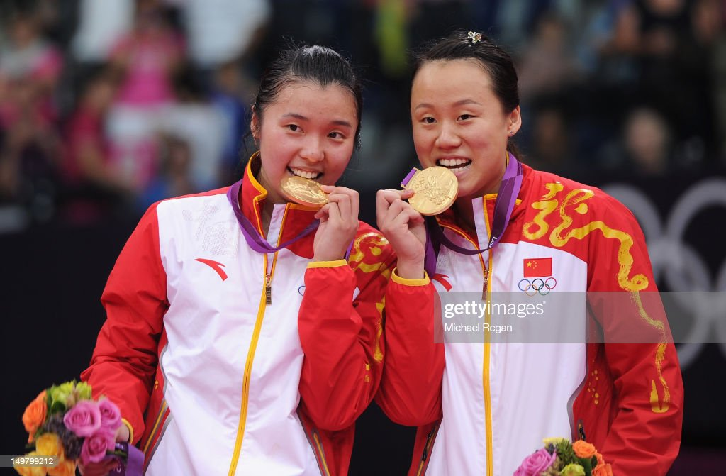 Yunlei Zhao (R) and Qing Tian of China stand on the podium with their Gold medals following their victory against Reika Kakiiwa and Mizuki Fujii of Japan during their Women's Doubles Badminton Gold Medal match on Day 8 of the London 2012 Olympic Games at Wembley Arena on August 4, 2012 in London, England.