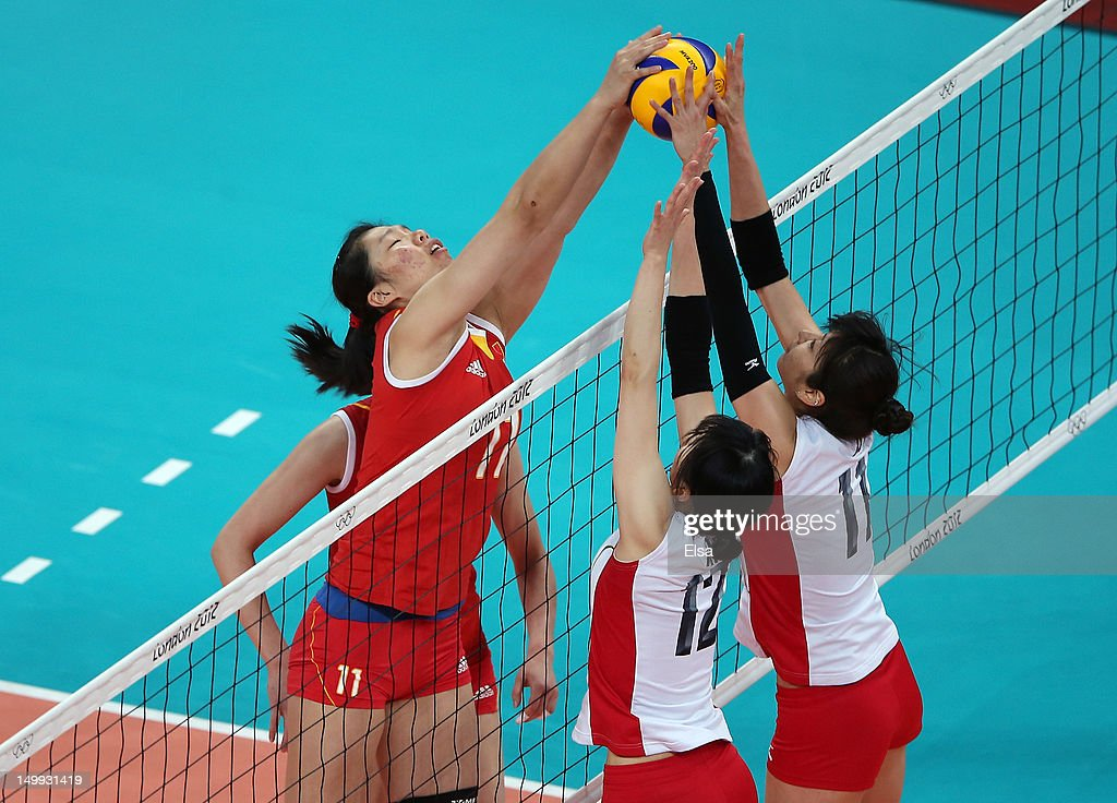 Yunli Xu #11 of China tries to get the ball past <a gi-track='captionPersonalityLinkClicked' href=/galleries/search?phrase=Ai+Otomo&family=editorial&specificpeople=2151622 ng-click='$event.stopPropagation()'>Ai Otomo</a> #11 and <a gi-track='captionPersonalityLinkClicked' href=/galleries/search?phrase=Risa+Shinnabe&family=editorial&specificpeople=8641931 ng-click='$event.stopPropagation()'>Risa Shinnabe</a> #12 of Japan during Women's Volleyball on Day 11 of the London 2012 Olympic Games at Earls Court on August 7, 2012 in London, England.
