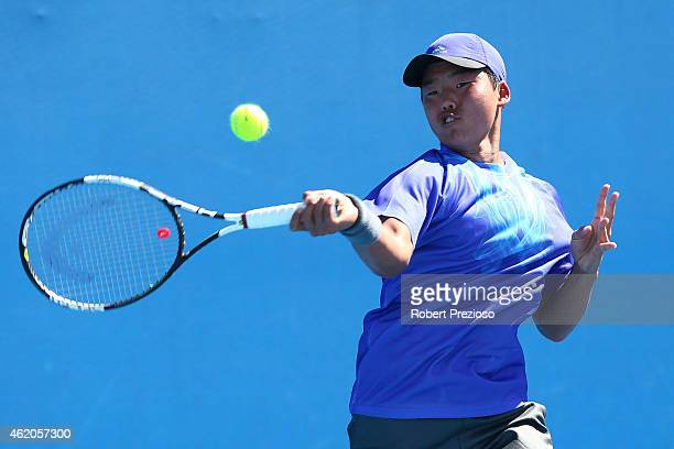 Yunseong Chung of Korea plays a shot in his match against Lloyd George Harris of South Africa during the Australian Open 2015 Junior Championships at...