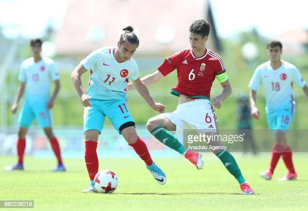 Yunus Akgün of Turkey in action against Dominik Szoboszal of Hungary during the UEFA European Under17 Championship quarterfinal soccer match between...
