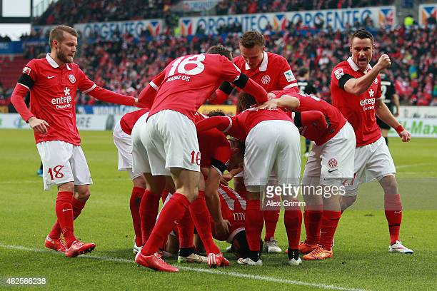 Yunus Malli celebrates his team's first goal with team mates during the Bundesliga match between 1 FSV Mainz 05 and SC Paderborn at Coface Arena on...