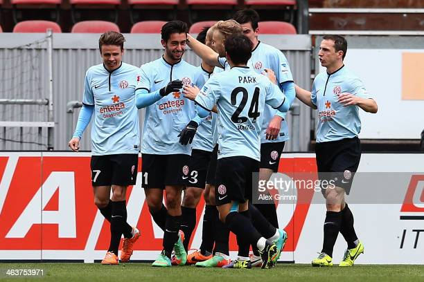 Yunus Malli celebrates his team's first goal with team mates during the friendly match between 1 FSV Mainz 05 and 1 FC Saarbruecken at...