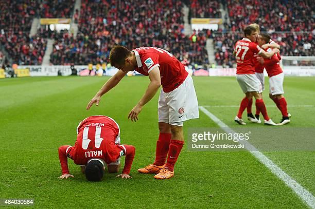 Yunus Malli of 1 FSV Mainz 05 celebrates as he scores the third goal during the Bundesliga match between 1 FSV Mainz 05 and Eintracht Frankfurt at...