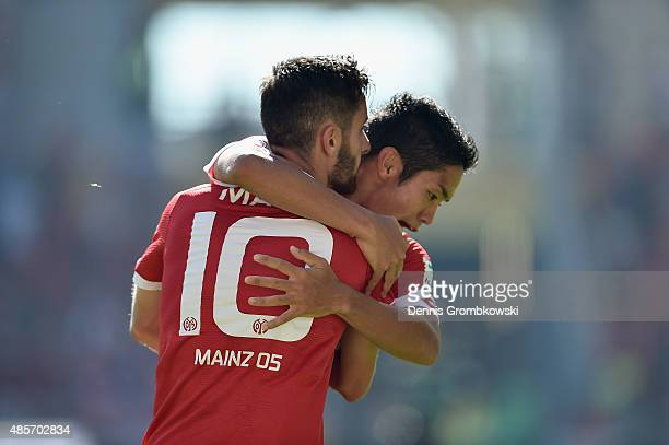 Yunus Malli of 1 FSV Mainz 05 celebrates with team mate Yoshinori Muto as he scores the third goal during the Bundesliga match between 1 FSV Mainz 05...