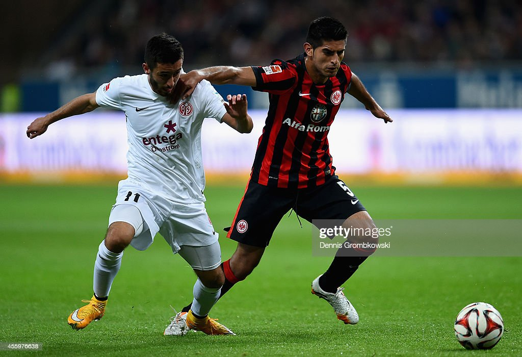 <a gi-track='captionPersonalityLinkClicked' href=/galleries/search?phrase=Yunus+Malli&family=editorial&specificpeople=5532598 ng-click='$event.stopPropagation()'>Yunus Malli</a> of FSV Mainz 05 and <a gi-track='captionPersonalityLinkClicked' href=/galleries/search?phrase=Carlos+Zambrano&family=editorial&specificpeople=203225 ng-click='$event.stopPropagation()'>Carlos Zambrano</a> of Eintracht Frankfurt battle for the ball during the Bundesliga match between Eintracht Frankfurt and 1. FSV Mainz 05 at Commerzbank-Arena on September 23, 2014 in Frankfurt am Main, Germany.