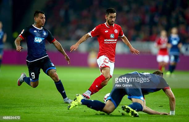 Yunus Malli of Mainz and Eduardo Vargas of Hoffenheim battle for the ball during the Bundesliga match between 1 FSV Mainz 05 and 1899 Hoffenheim at...