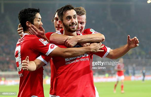 Yunus Malli of Mainz celebrate with his team mates after he scores the 3rd goal the Bundesliga match between 1 FSV Mainz 05 and 1899 Hoffenheim at...
