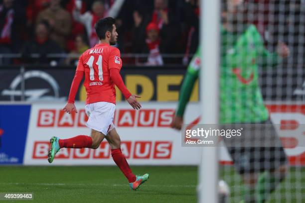 Yunus Malli of Mainz celebrates his team's first goal during the Bundesliga match between 1 FSV Mainz 05 and Hannover 96 at Coface Arena on February...
