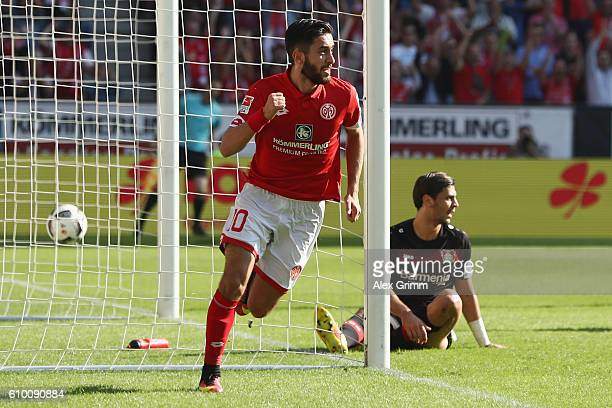 Yunus Malli of Mainz celebrates his team's first goal during the Bundesliga match between 1 FSV Mainz 05 and Bayer 04 Leverkusen at Opel Arena on...