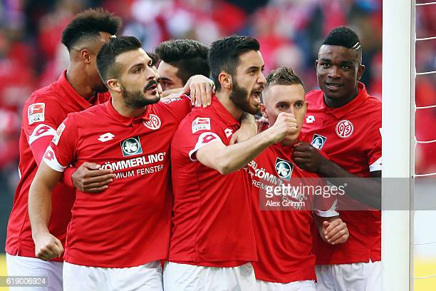 Yunus Malli of Mainz celebrates his team's first goal with team mates during the Bundesliga match between 1 FSV Mainz 05 and FC Ingolstadt 04 at Opel...