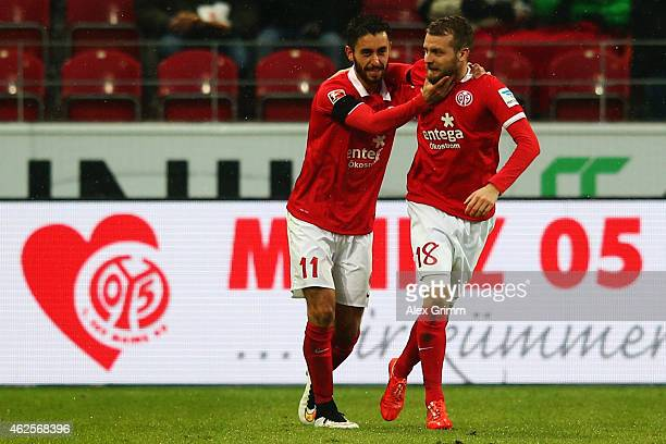Yunus Malli of Mainz celebrates his team's second goal with team mate Daniel Brosinski during the Bundesliga match between 1 FSV Mainz 05 and SC...