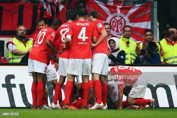 Yunus Malli of Mainz celebrates his team's third goal with team mates during the Bundesliga match between 1 FSV Mainz 05 and Hamburger SV at Coface...