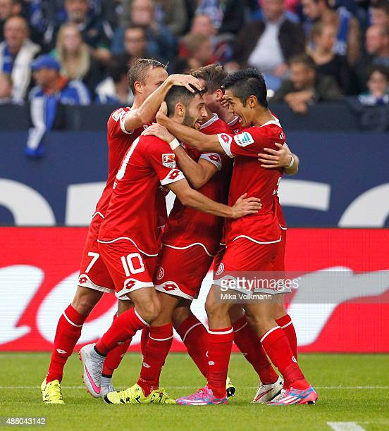 Yunus Malli of Mainz celebrates scoring the 11 with Yoshinori Muto of Mainz and teammates during the Bundesliga match between FC Schalke 04 and 1 FSV...