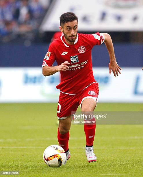 Yunus Malli of Mainz runs with the ball during the Bundesliga match between FC Schalke 04 and 1 FSV Mainz 05 at VeltinsArena on September 13 2015 in...