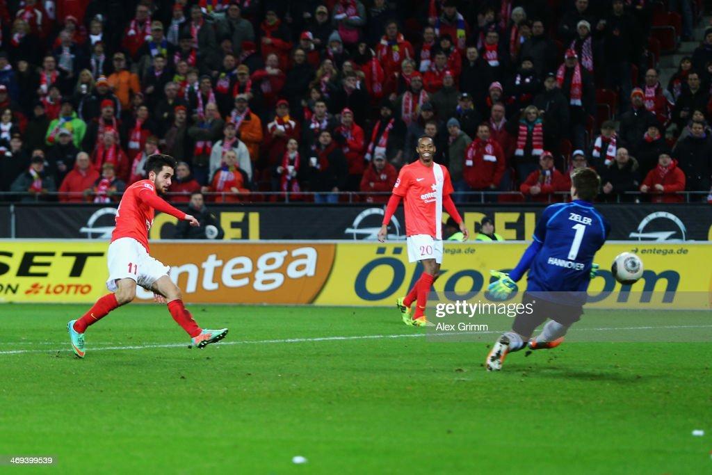 Yunus Malli of Mainz scores his team's first goal against goalkeeper RonRobert Zieler of Hannover during the Bundesliga match between 1 FSV Mainz 05...
