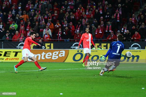 Yunus Malli of Mainz scores his team's first goal against goalkeeper RonRobert Zieler of Hannover during the Bundesliga match between 1 FSV Mainz 05...