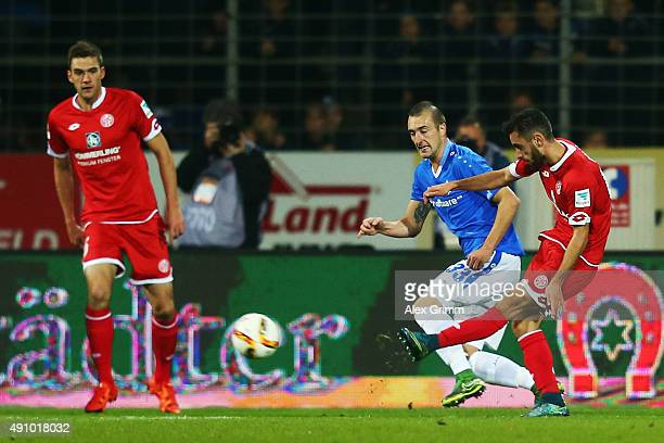 Yunus Malli of Mainz scores his team's second goal against Luca Caldirola of Darmstadt during the Bundesliga match between SV Darmstadt 98 and 1FSV...