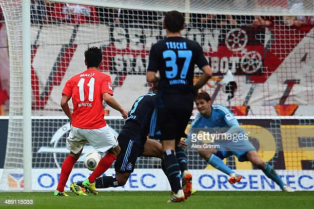 Yunus Malli of Mainz scores his team's second goal during the Bundesliga match between 1 FSV Mainz 05 and Hamburger SV at Coface Arena on May 10 2014...