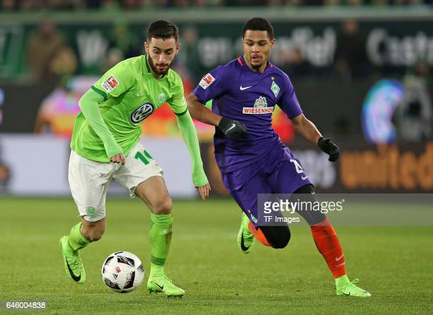 Yunus Malli of Wolfsburg and Serge Gnabry of Werder Bremen battle for the ball during the Bundesliga match between VfL Wolfsburg and Werder Bremen at...