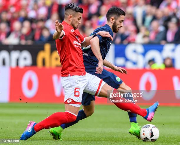 Yunus Malli of Wolfsburg challenges Danny Latza of Mainz 05 during the Bundesliga match between 1 FSV Mainz 05 and VfL Wolfsburg at Opel Arena on...