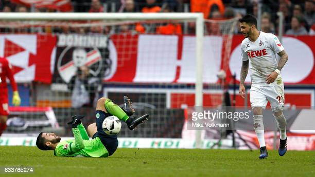 Yunus Malli of Wolfsburg falls against Leonardo Bittencourt of Cologne during the Bundesliga match between 1 FC Koeln and VfL Wolfsburg at...