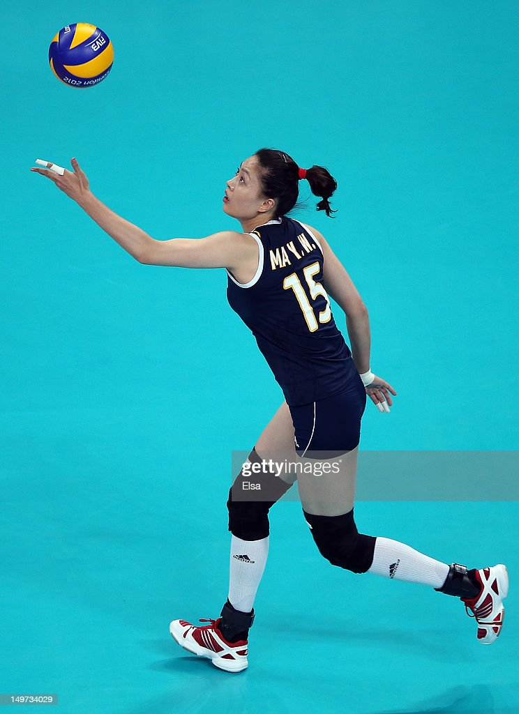 <a gi-track='captionPersonalityLinkClicked' href=/galleries/search?phrase=Yunwen+Ma&family=editorial&specificpeople=5485134 ng-click='$event.stopPropagation()'>Yunwen Ma</a> #15 of China serves the ball to Brazil during Women's Volleyball on Day 7 of the London 2012 Olympic Games at Earls Court on August 3, 2012 in London, England.