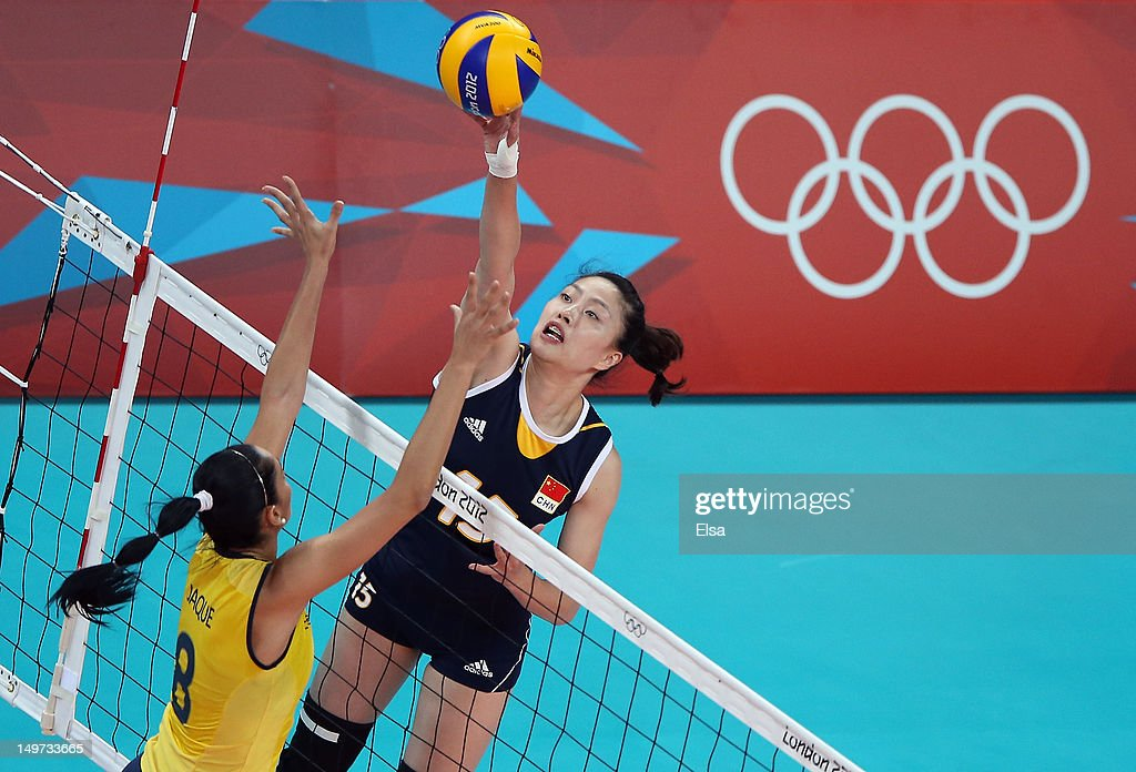 <a gi-track='captionPersonalityLinkClicked' href=/galleries/search?phrase=Yunwen+Ma&family=editorial&specificpeople=5485134 ng-click='$event.stopPropagation()'>Yunwen Ma</a> #15 of China spikes the ball as Jaqueline Carvalho #8 of Brazil defends on Day 7 of the London 2012 Olympic Game at Earls Court on August 3, 2012 in London, England.