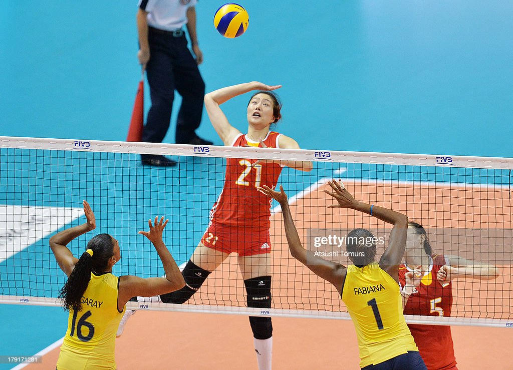 <a gi-track='captionPersonalityLinkClicked' href=/galleries/search?phrase=Yunwen+Ma&family=editorial&specificpeople=5485134 ng-click='$event.stopPropagation()'>Yunwen Ma</a> of China spikes the ball during day five of the FIVB World Grand Prix Sapporo 2013 match between China and Brazil at Hokkaido Prefectural Sports Center on September 1, 2013 in Sapporo, Hokkaido, Japan.
