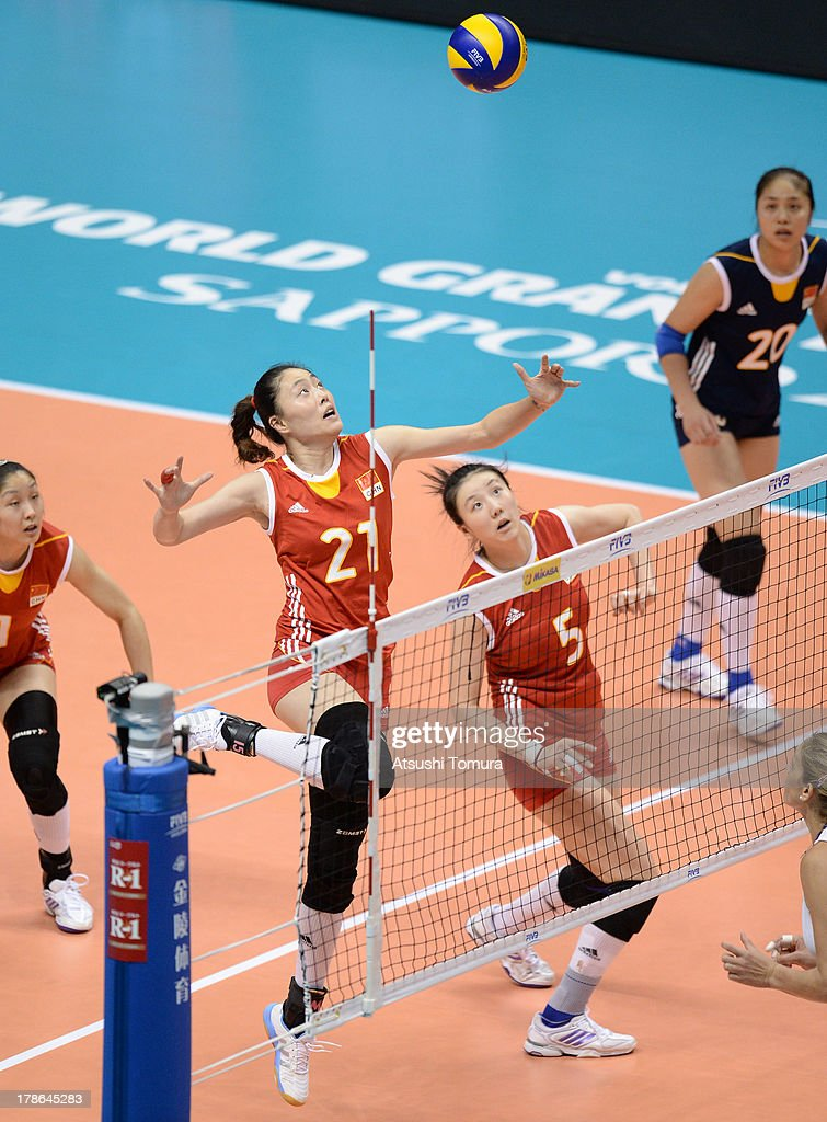 Yunwen Ma of China spikes the ball during day three of the FIVB World Grand Prix Sapporo 2013 match between China and USA at Hokkaido Prefectural Sports Center on August 30, 2013 in Sapporo, Hokkaido, Japan.