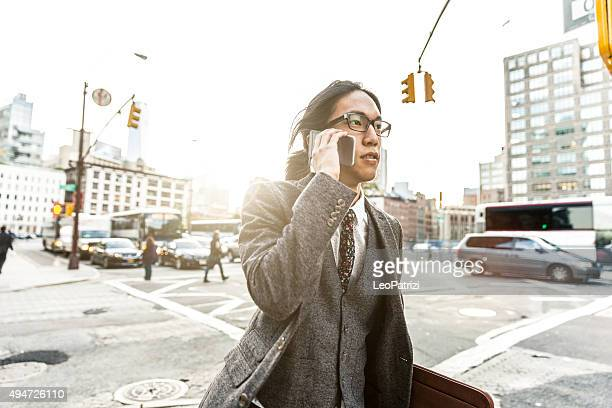 Yuppie businessman on mobile in Soho New York