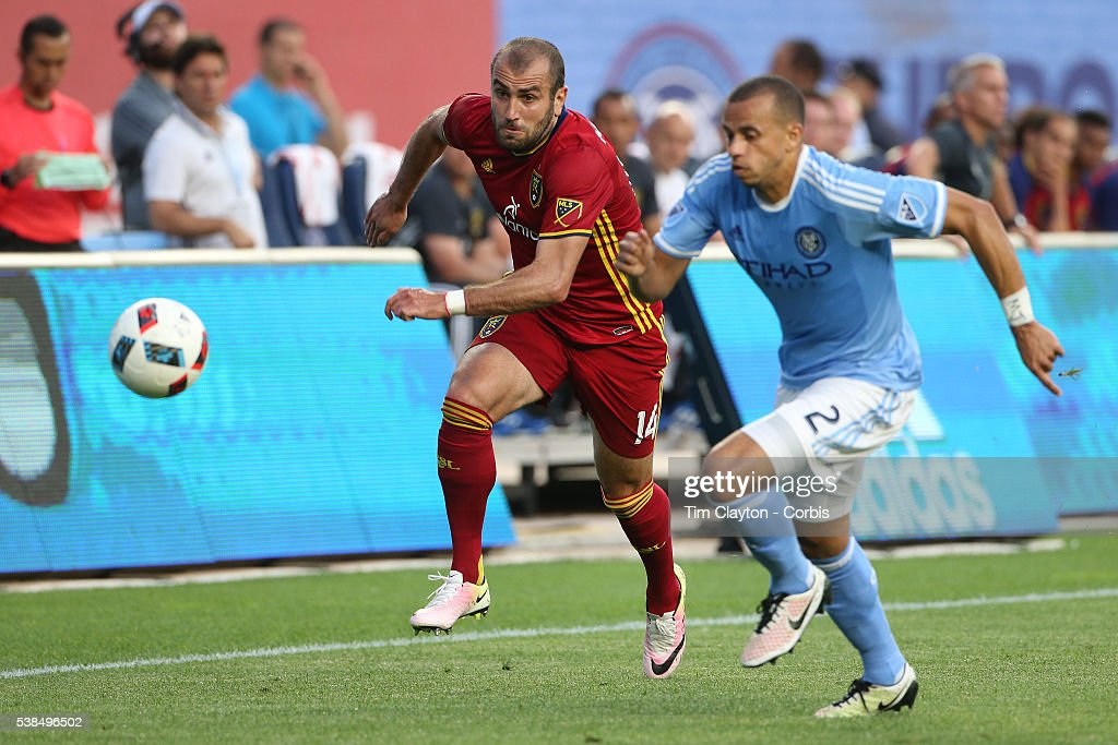 Yura Movsisyan #14 of Real Salt Lake is challenged by <a gi-track='captionPersonalityLinkClicked' href=/galleries/search?phrase=Jason+Hernandez+-+American+Soccer+Player&family=editorial&specificpeople=9684404 ng-click='$event.stopPropagation()'>Jason Hernandez</a> #2 of New York City FCin action during the NYCFC Vs Real Salt Lake regular season MLS game at Yankee Stadium on June 02, 2016 in New York City.
