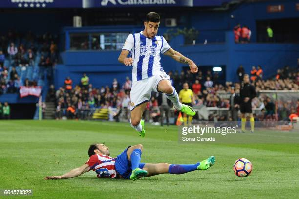 Yuri #19 of Real Sociedad and Juanfran #20 of Atletico de Madrid during The La Liga match between Club Atletico de Madrid v Real Sociedad de Futbol...