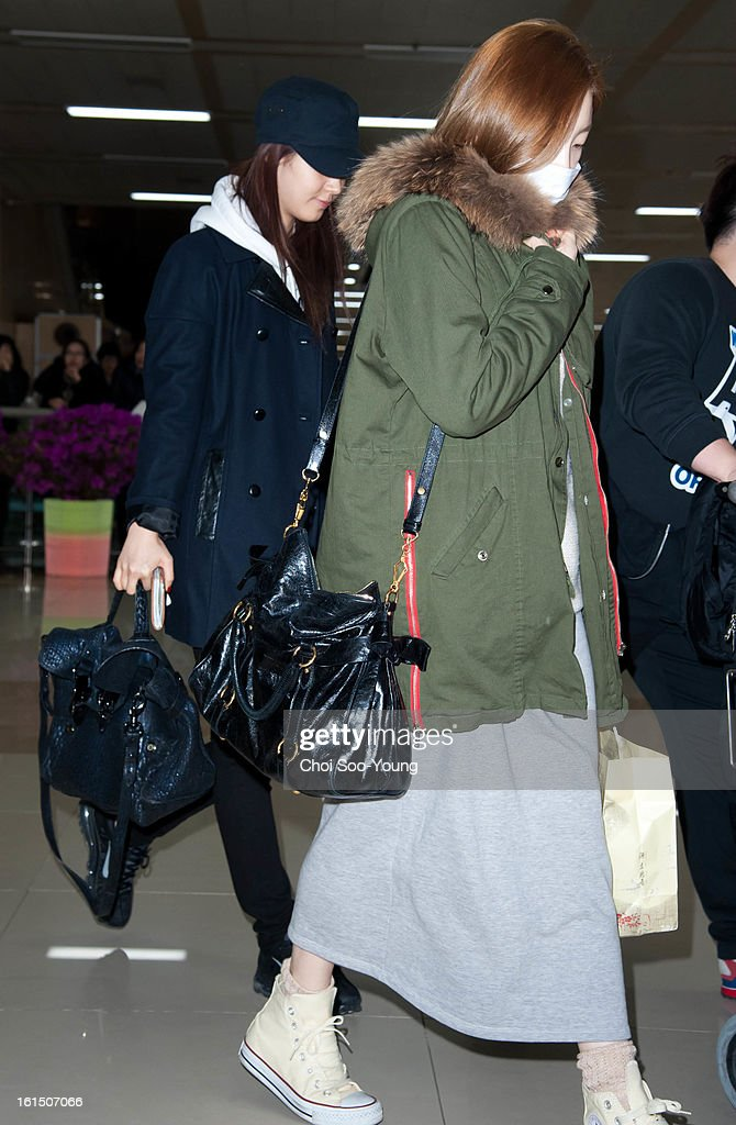 Yu-Ri and Tae-Yeon of Girls' Generation are seen at Gimpo International Airport on February 11, 2013 in Seoul, South Korea.