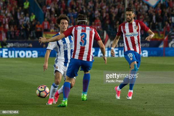 Yuri B evade Filipe Luis meanwhile Yanick Carrasco cover the pass during the match between Atletico de Madrid and Real Sociedad AtMadrid won over...