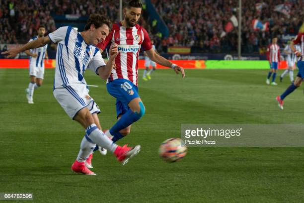 Yuri B pass the ball evading Yanick Carrasco during the match between Atletico de Madrid and Real Sociedad AtMadrid won over Real Sociedad with 10