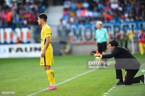 Yuri Berchiche and Unai Emery Coach of PSG during the Ligue 1 match between Montpellier Herault SC and Paris Saint Germain at Stade de la Mosson on...