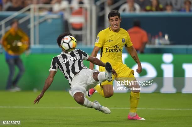 Yuri Berchiche of Paris SaintGermain and Juan Cuadrado of Juventus vie for the ball during their International Champions Cup football match on July...